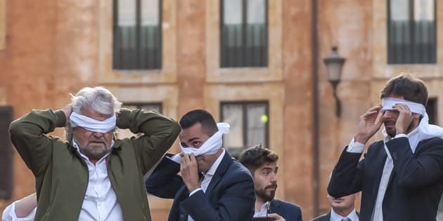 ROME, ITALY - OCTOBER 25: Leaders  Five Star Movement (M5S) Beppe Grillo (L), Luigi Di Maio (C) and Alessandro Di Battista (R) cover their eyes with a white scraf during the  demonstration by the 5 Star Movement (M5S)  in front of the Pantheon  against the government's decision to put a bill for a new electoral law (known as 'Rosatellum') to a confidence vote on October 25, 2017 in Rome, Italy. (Photo by Stefano Montesi - Corbis/Corbis via Getty Images)