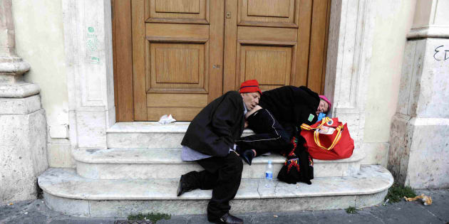 ROMA, ITALY - NOVEMBER 6 : Two homeless people sleep on the steps of the post office building in Piazza San Silvestro on November 6, 2008 in Rome, Italy. (Photo by Stefano Montesi/Corbis via Getty Images)