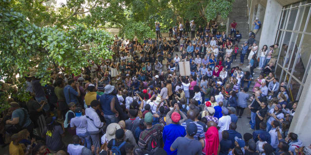 University of Cape Town students gather during the #FeesMustFall protest on October 03, 2016 in Cape Town.