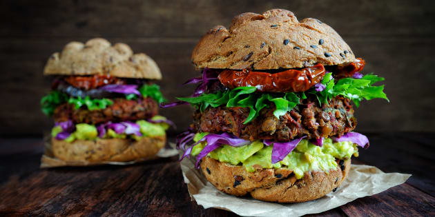 Fresh beetroot and lentil vegan 'burger' with grilled eggplant, sun-dried tomatoes and guacamole sauce.