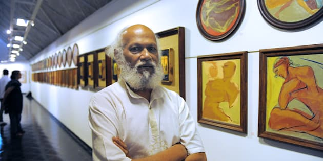 Indian artist Jatin Das poses at an art exhibition in Ahmedabad.