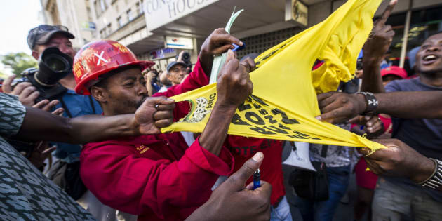 Economic Freedom Fighters supporters tear an ANC  t-shirt outside Parliament during President Jacob Zumaï's State of the Nation Address.