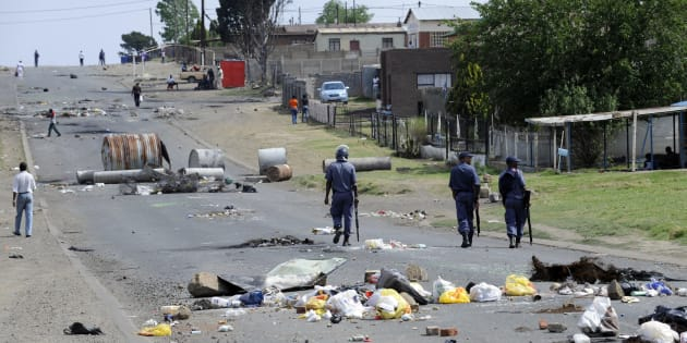 Sakhile is not new to protests. Police patrol a street in the township following a service delivery protest in 2009.