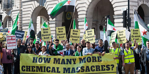 Hundreds of people take part in a protest against the use of chemical warfare in war-torn Syria in response to a recent chemical attack in Khan Sheikhoun in Idlib province, where at least 85 civilians died and hundreds were injured, on April 08, 2017 in London, England.