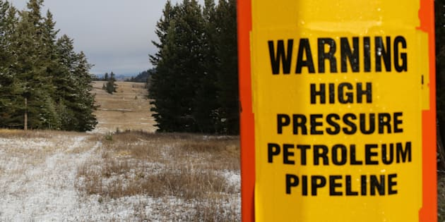 A sign warning of the subterranean presence of Kinder Morgan's Trans Mountain Pipeline in seen in ranchland outside Kamloops, B.C. on Nov. 16, 2016.