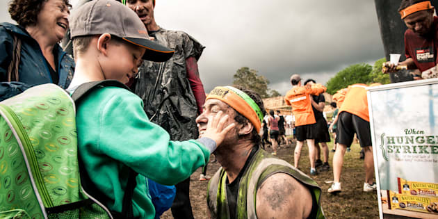 Robin Braidwood and his seven-year-old son Kyte after finishing Tough Mudder. Robin is completely blind.