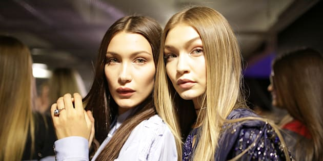 MILAN, ITALY - SEPTEMBER 23: Bella Hadid and Gigi Hadid backstage at the Versace Ready to Wear show during Milan Fashion Week Spring/Summer 2017 on September 23, 2016 in Milan, Italy. (Photo by Victor VIRGILE/Gamma-Rapho via Getty Images)