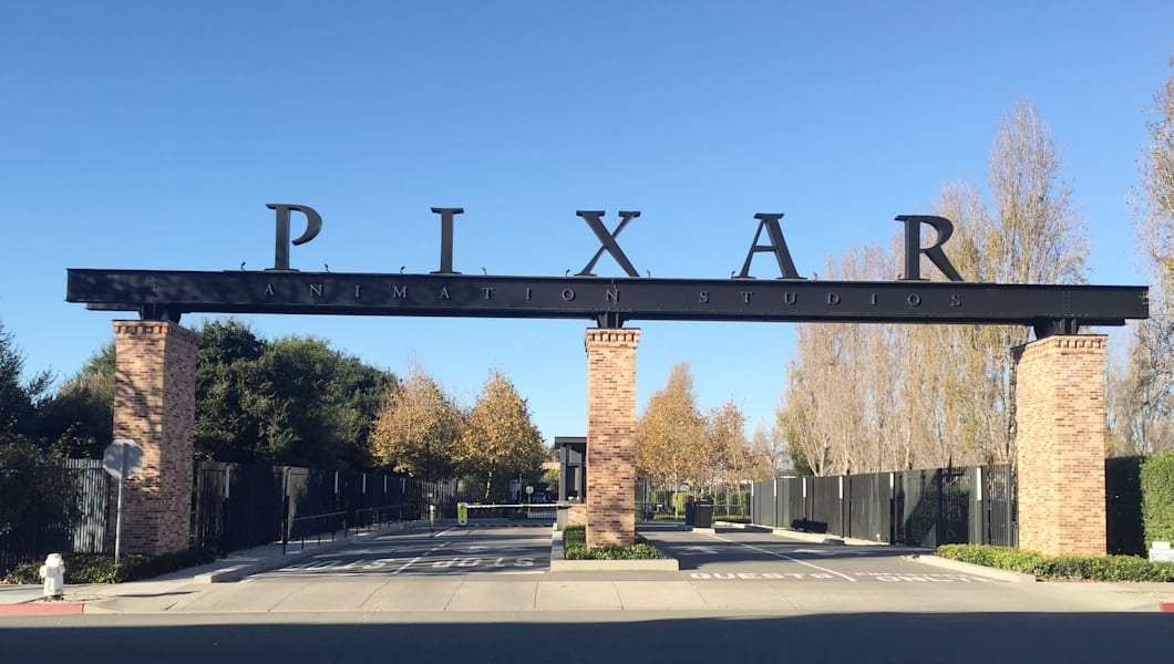 The gates to Pixar's campus is seen in Emeryville, California, on November 29, 2016. Over 21 years of unparalleled success, the executives at animation studio Pixar have developed an aphorism they are fond of repeating -- that their movies are never finished, just released. The motto speaks to the perfectionism that has seen the company gross almost $11 billion and win 13 Oscars since 'Toy Story' blazed a trail as the world's first feature-length computer-generated animation in 1995.   / AFP / Frankie TAGGART / TO GO WITH AFP STORY BY FRANKIE TAGGART-'Pixar celebrates 21 years with 'love letter' to Mexico'        (Photo credit should read FRANKIE TAGGART/AFP/Getty Images)