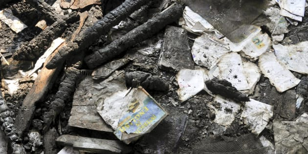 Burnt books inside the gutted building of government school at Gori Pora on October 31, 2016 in Srinagar, India.