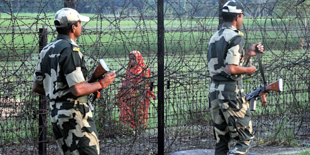 Indian Border Security Force (BSF) soldiers patrolling at the near Petrapole Border outpost at the India-Bangladesh Border on the outskirts of Kolkata.