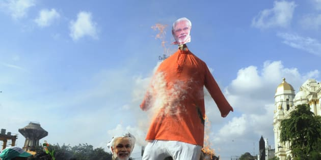 Trinamool Congress (TMC) members burned an effigy of Prime Minister Narendra Modi in a protest demonstration against price hike of petrol and diesel at Esplanade  on September 10, 2018 in Kolkata, India.  There were a series of interesting protests in Kerala.