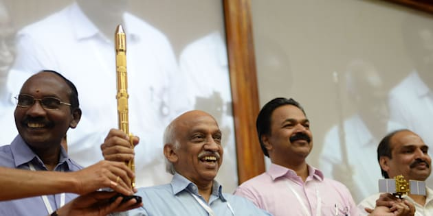 Indian Space Research Organisation (ISRO) chairman Kiran Kumar Reddy (C) gestures while meeting with the media after the Indian Space Research Organisation's (ISRO) earth observation satellite CARTOSAT-2, on board the Polar Satellite Launch Vehicle (PSLV-C40), along with 28 satellites from six foreign countries, including the US, France, Finland, Republic of Korea and Canada, was launched at Satish Dawan space center in Sriharikota on January 12, 2018.