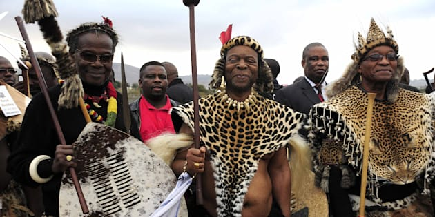 Prince Mangosuthu Buthelezi and Jacob Zuma with Zulu King Goodwill Zwelithini during one of the monarch's weddings at Ondini Sports Complex on July 26 2014, in Ulundi.