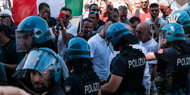 Protest employees and owners of Roman car wreckers against the plan to relocate the scrapers that, they say, could lead to the closure of the activities. In the square also militants of CasaPound with lots of flags. A few moments of tension occurred when a group approached the cordon of policemen and carabinieri to protect the ascent leading to the Capitoline Hill on July 12, 2018 in Rome, Italy. (Photo by Andrea Ronchini/NurPhoto via Getty Images)
