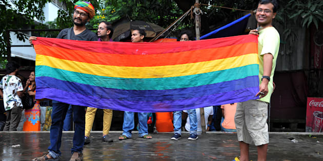 Members of LGBT community celebrate at the Supreme Court of India after the decision to strike down the colonial-era ban on gay sex.