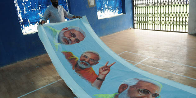 Painter Raj Saini showing the paintings of Prime Minister Narendra Modi on the occasion of his 65th birthday.