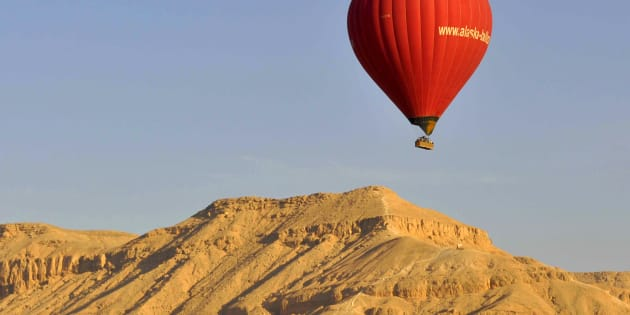 A hot air balloon flies over Luxor on April 21, 2013.