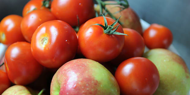 Fresh tomatoes mixed with apples