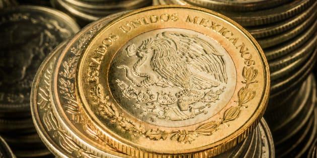 Peso, la moneda mexicana perdió ayer frente al dólar.