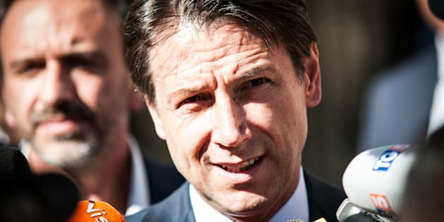 Italian Prime Minister Giuseppe Conte speaks to journalists outside Chigi Palace, in Rome, on 28 September 2018. Italy's stock market fell sharply Friday after the populist, euroskeptic government announced a sharp public spending increase that will push the budget deficit to 2.4 percent of gross domestic product next year, risking a collision with the European Union. (Photo by Andrea Ronchini/NurPhoto via Getty Images)