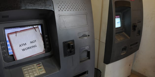 GURGAON, INDIA - DECEMBER 29: After the fifty days of demonetization, no cash in Axis Bank ATM machine in sector-14, on December 29, 2016 in Gurgaon, India. (Photo by Parveen Kumar/Hindustan Times via Getty Images)