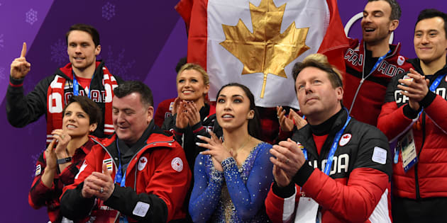 Canada's Gabrielle Daleman, front centre, reacts after competing in the figure skating team event. Canada won a gold medal in the team event.