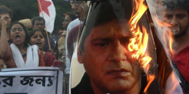 Indian leftist activists burn an effigy of actor and Trinamool Congress MP Tapas Pal in Kolkata on July 5, 2014.