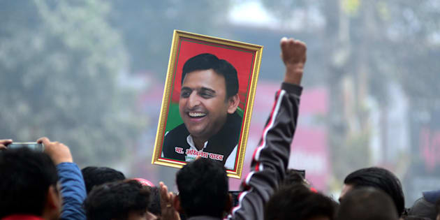 An Indian supporter of Uttar Pradesh's Chief Minister Akhilesh Yadav holds the photograph of Akhilesh Yadav as they  protest against the evictions of Akhilesh Yadav from Samajwadi Party for 6 years , in Allahabad on December 31,2016.