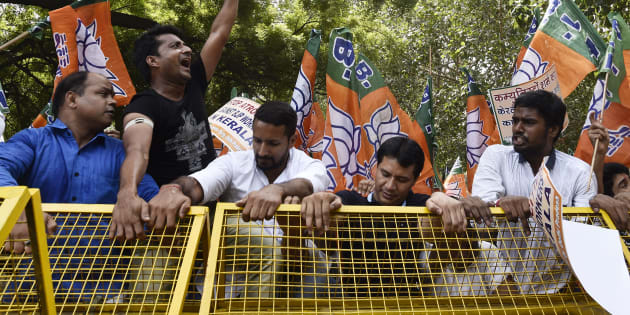 Delhi BJP supporters shout slogans against CPI(M) leadership to protest the attacks on RSS workers in Kerala.