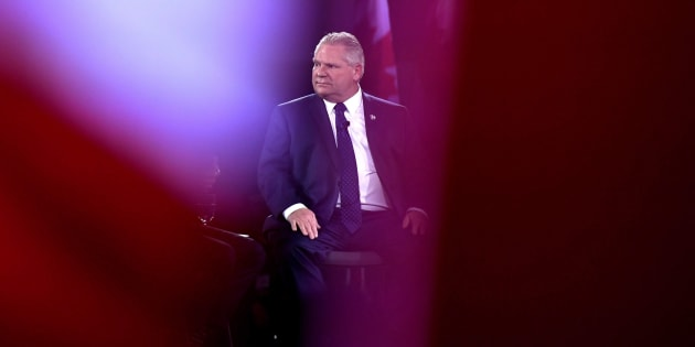 Before being elected Ontario PC Party leader, candidate Doug Ford is seen past Canadian flags as he participates in a question-and-answer session at the Manning Networking Conference in Ottawa on Feb. 10, 2018.