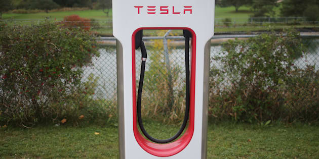Chris Helgren  Reuters                       A Tesla electric vehicle charger is seen on a river bank at the edge of a parking lot in Kitchener Ont. Oct. 13 2017