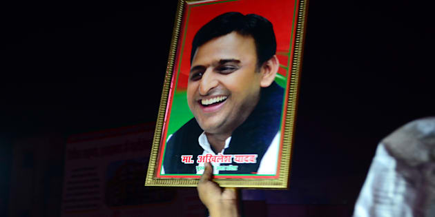 An Indian supporter of Uttar Pradesh's Chief Minister Akhilesh Yadav holds the photograph of Akhilesh Yadav as they protest against the eviction of Akhilesh Yadav from Samajwadi Party for 6 years.