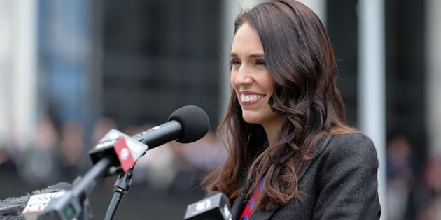New Zealand's prime minister, Jacinda Ardern, makes a speech upon her arrival at Parliament after a swearing-in ceremony at Government House on October 26, in Wellington, New Zealand. Ardern says her government is moving quickly to institute a ban of foreigners buying homes in the country.