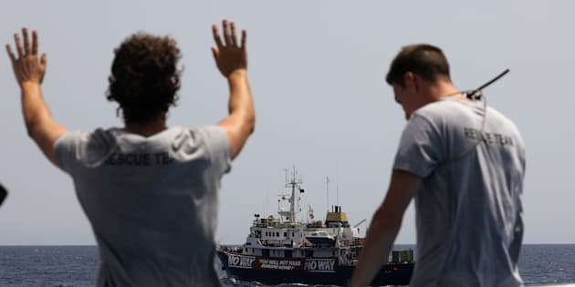 Lifeguards from the Spanish NGO Proactiva Open Arms aboard the former fishing trawler Golf Azzurro watch the C Star vessel run by a group of anti-immigration activists in the Western Mediterranean Sea August 15, 2017. REUTERS/Yannis Behrakis