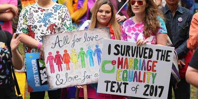 People show their support at the YES March for Marriage Equality on October 21, 2017 in Sydney, Australia.