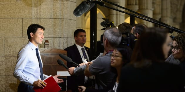 Prime Minister Justin Trudeau pauses to talk to media as he arrives to a caucus meeting on Parliament Hill in Ottawa on Sept. 19, 2018.