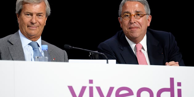 Chairman of the Supervisory Board of French media group Vivendi Vincent Bollore (L) and Vivendi CEO Arnaud de Puyfontaine (R) take part in the group's general meeting in Paris on April 25, 2017. / AFP PHOTO / ERIC PIERMONT        (Photo credit should read ERIC PIERMONT/AFP/Getty Images)