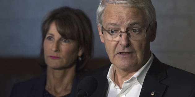 Quebec Immigration Minister Kathleen Weil, left, looks on as Marc Garneau responds to a question during a news conference following a meeting on Parliament Hill on Sept. 1, 2017.