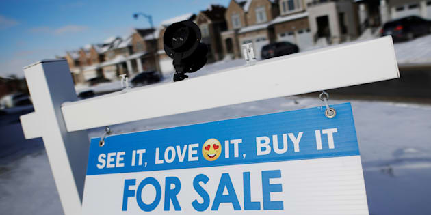 A real estate for sale sign at a newly-built subdivision in East Gwillimbury, Ont., Jan. 30, 2018. The Canadian Real Estate Association says home sales in July were up 1.9 per cent compared with June.
