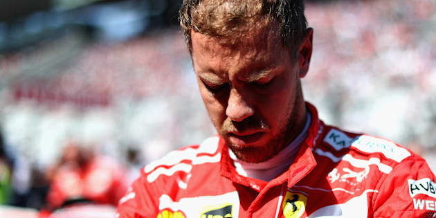 SUZUKA, JAPAN - OCTOBER 08:  Sebastian Vettel of Germany and Ferrari prepares to drive on the grid before the Formula One Grand Prix of Japan at Suzuka Circuit on October 8, 2017 in Suzuka.  (Photo by Lars Baron/Getty Images)