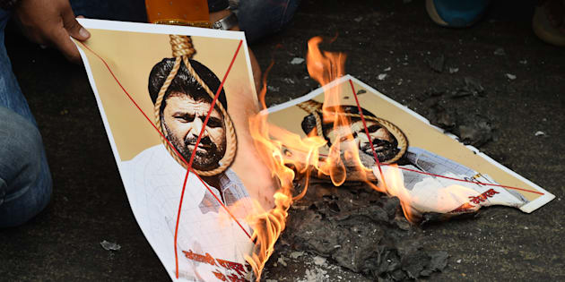 Activists of Indian right-wing Hindu organization Hindu Sena burn photographs of Yakub Memon.