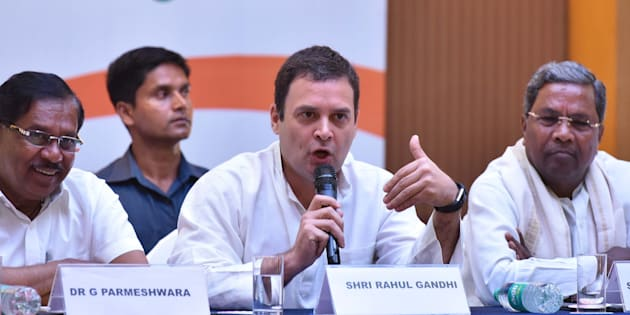BENGALURU, INDIA - MAY 10:  All India Congress Committee president Rahul Gandhi flanked by Karnataka Pradesh Congress Committee president G Parmeshwara (L) and Karnataka Chief Minister Siddaramaiah (R) during a press conference on the last day of campaigning ahead of state assembly election at a city hotel   on May 10, 2018 in Bengaluru, India.   (Photo by Arijit Sen/Hindustan Times via Getty Images)