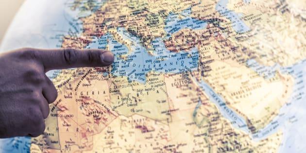 A macro closeup of a political globe focusing on Mediterranean Sea