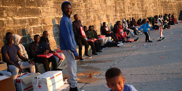 Un grupo de migrantes, atendidos en el puerto de Tarifa tras cruzar el Estrecho el pasado 26 de julio.