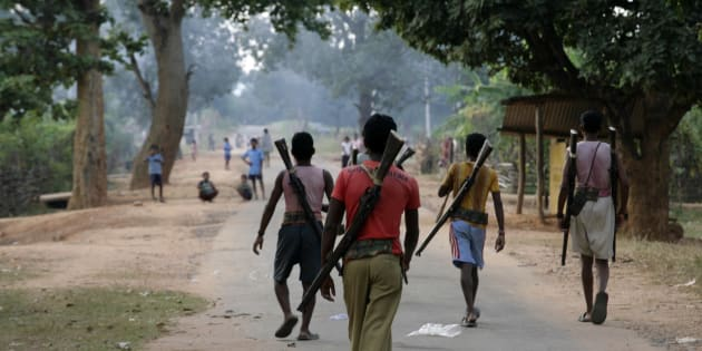 This file photo shows special police officers walking at a Salwa Judum, or purification hunt camp in Dantewada.