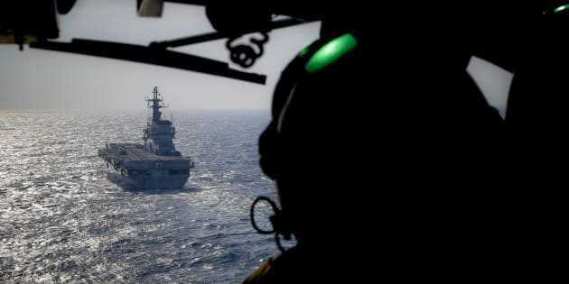In this Friday, Nov. 25, 2016 photo, the Italian Navy Giuseppe Garibaldi light aircraft carrier, seen from a helicopter, sails on the Mediterranean Sea, off the coast of Sicily, part of the European Union's naval force Operation Sophia. Operation Sophia was launched to disrupt human smuggling operations in the Central Mediterranean. (AP Photo/Nicolae Dumitrache)