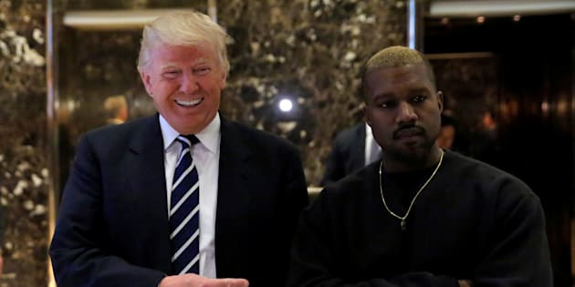 """I'm with him."" US President-elect Donald Trump and musician Kanye West pose for media at Trump Tower in Manhattan on 13 December 2016."