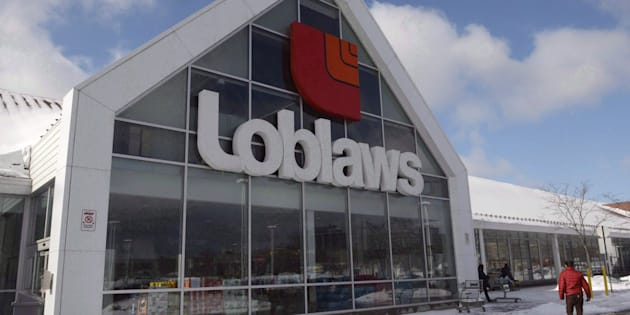 A Loblaws store is seen Monday, March 9, 2015 in Montreal. Parent company George Weston Ltd.'s profit in the fourth quarter was cut by two-thirds as a result of special items including the cost of a $25 Loblaw Card program launched in compensation for the company's involvement in a price-fixing scheme.
