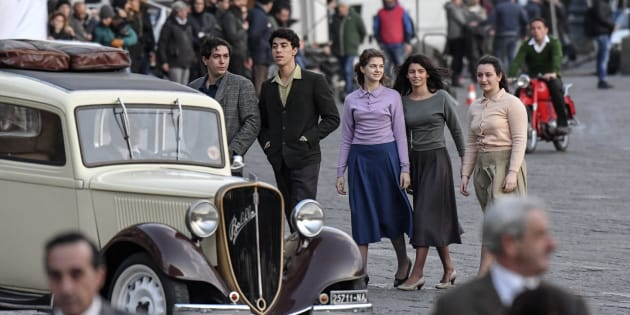 NAPLES, CAMPANIA, ITALY - 2018/03/13: Set TV series a genial friend (Amica Geniale), based on a novel by Elena Ferrante, scenes shot in Plebiscito square. Italian and American production with HBO, Wild Side and Rai, directed by Italian director Saverio Costanzo, in center scene the young actress Margherita Mazzucco (C-L) alias Elena and Gaia Girace (C-R) alias Lila. (Photo by Salvatore Laporta/KONTROLAB /LightRocket via Getty Images)