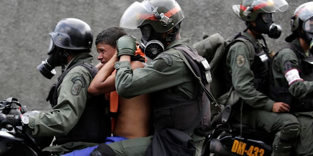 An opposition supporter is detained by riot police during a rally against Venezuela's President Nicolas Maduro in Caracas, Venezuela, April 26, 2017.